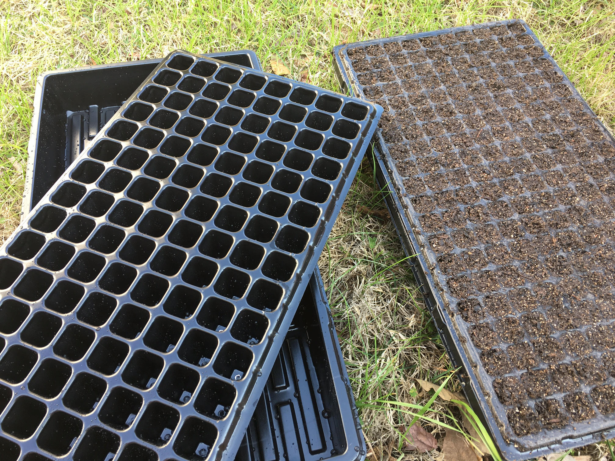 loading up our new bootstrap farmer seed trays with seed starting mix new gardeners be