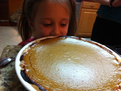Our adorable niece waiting for a pumpkin pie to cool at Tyrant Farms. Uses for Halloween pumpkins