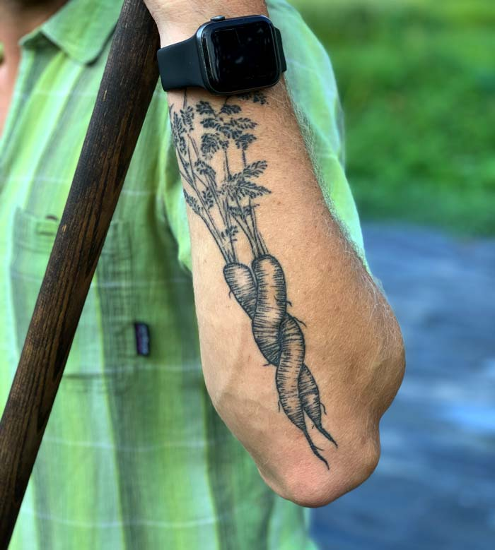Chris is a no-frills kinda guy, but he did invest in a new intertwined carrot tattoo for his arm, inspired by carrots he pulled on the farm. This tattoo pretty well sums up his intertwined relationship with food as well.