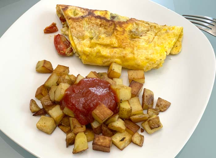 A quick popular meal at our house: pan-roasted potatoes with lacto-fermented ketchup plus duck egg omelette (with roasted tomatoes inside, of course).