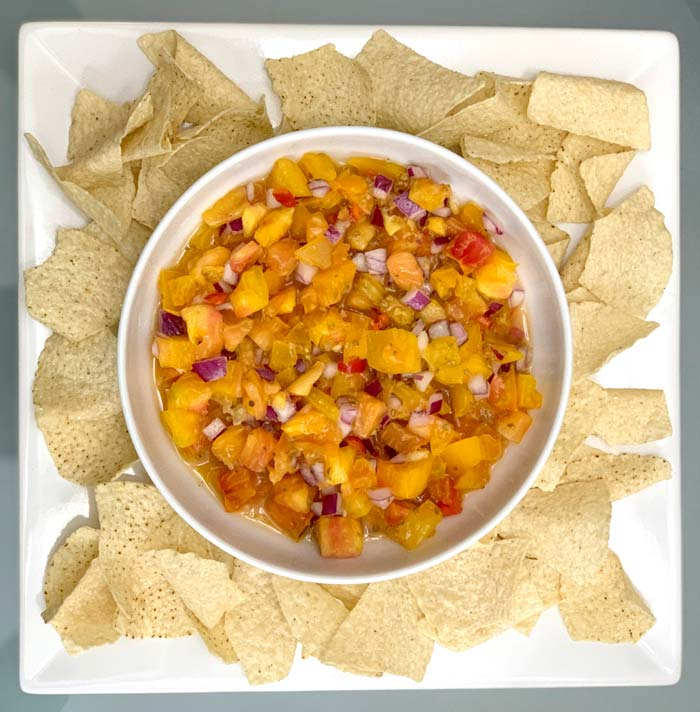 Pico de gallo - perfect as a standalone dish with tortilla chips or added to tacos, quesadillas, or other Latin American cuisine.