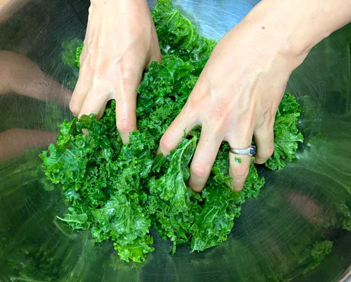 De-stem and give thicker leafy greens like mature kale an oil massage prior to using them in a salad. This vastly improves their texture for raw eating.