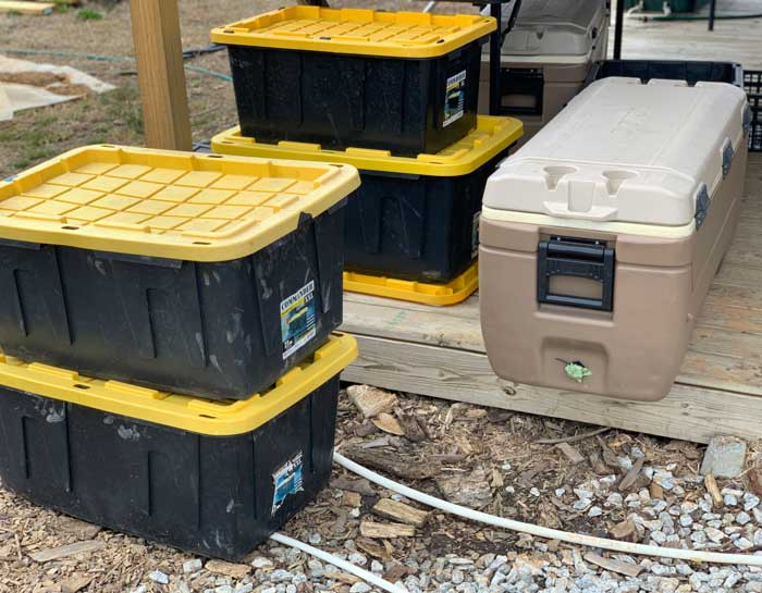 Some of the Chris's totes and coolers to help with harvesting, processing, and delivery.