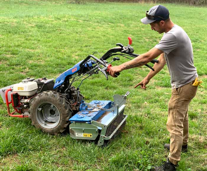 Chris showing how the various implements on his BCS tractor work.